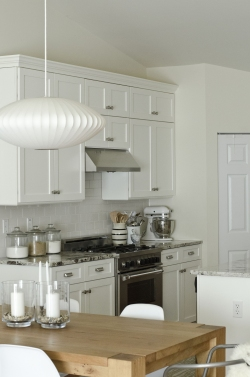 White cabinet refacing results.